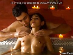 Indian woman is shrieking while a jaw-dropping man is mildly pawing her cootchie, in the tub